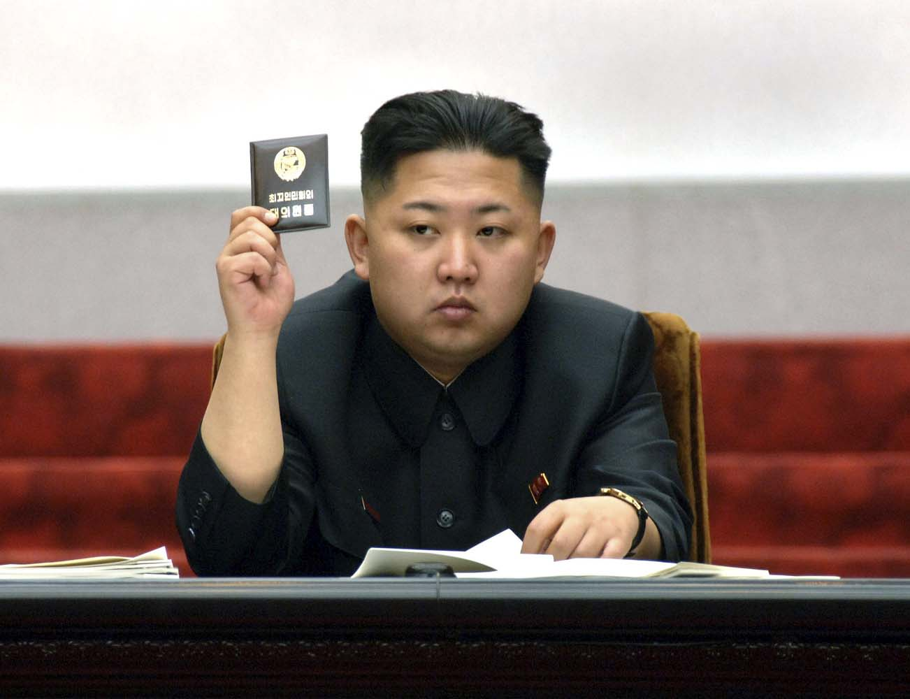 North Korean leader Kim Jong-Un holds up his ballot during the fifth session of the 12th Supreme People