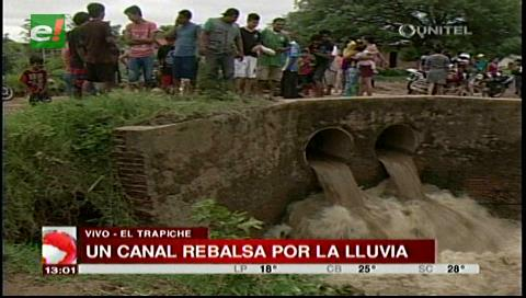 Reportan rebalse del canal de drenaje por la lluvia en la zona de El Trapiche