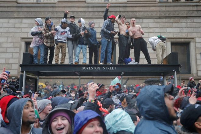 Fans watch the New England Patriots victory parade through the streets of Boston after winning Super Bowl LI, in Boston
