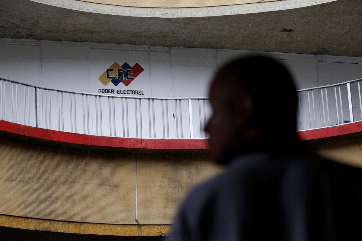 A man walks in a building of the National Electoral Council (CNE) in Caracas, Venezuela July 28, 2017. REUTERS/Marco Bello
