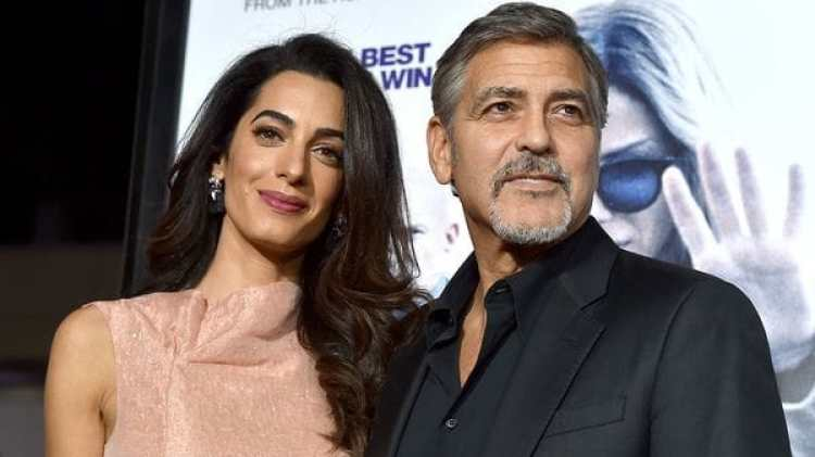 "HOLLYWOOD, CA – OCTOBER 26: Amal Alamuddin (L) and actor George Clooney attend the premiere of Warner Bros. Pictures' ""Our Brand Is Crisis"" at TCL Chinese Theatre on October 26, 2015 in Hollywood, California. (Photo by Kevin Winter/Getty Images)"