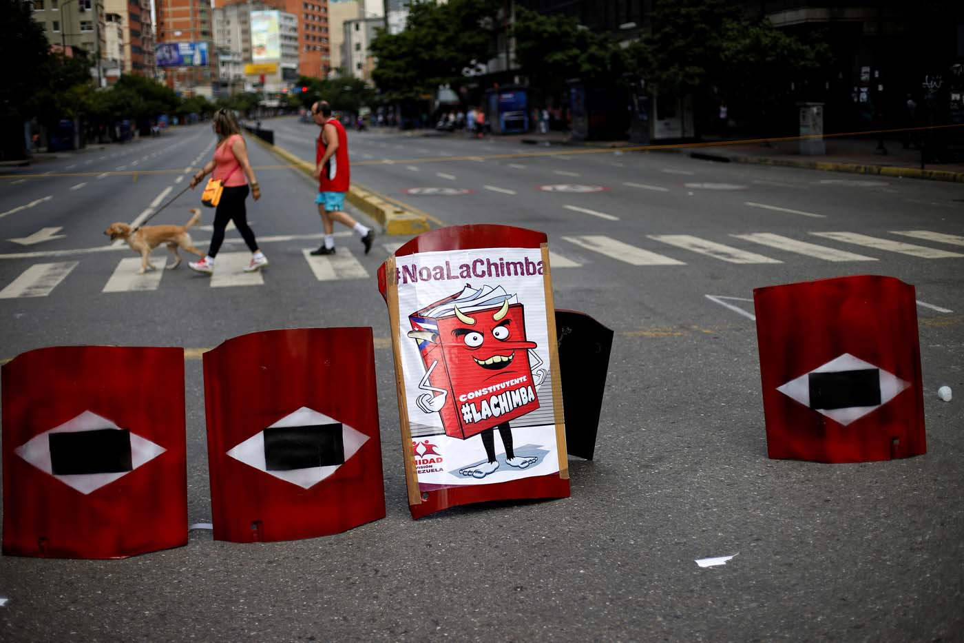 Makeshift shields lie on a blocked road during a strike called to protest against Venezuelan President Nicolas Maduro