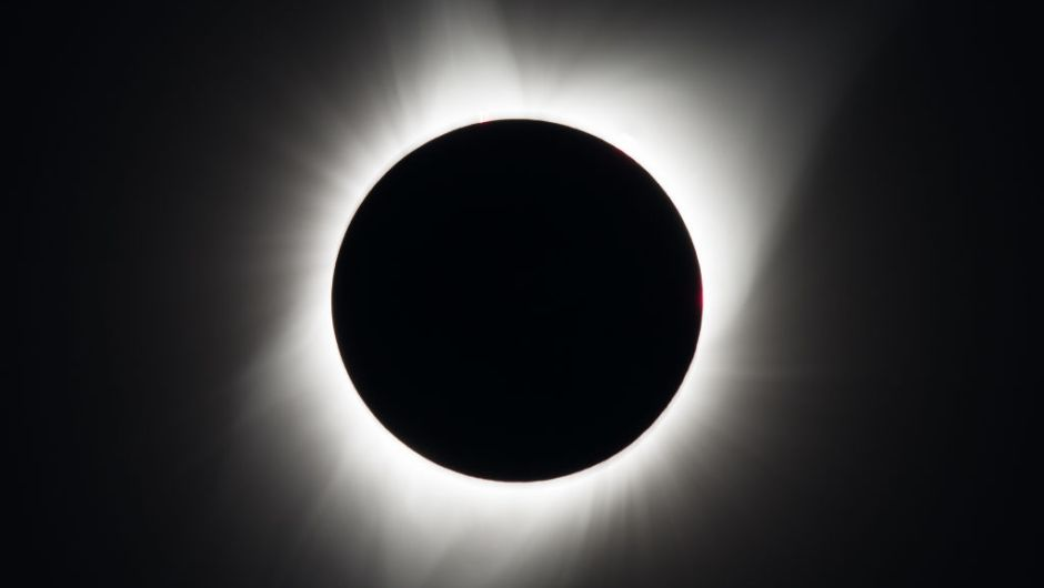 A total solar eclipse is seen on Monday, August 21, 2017 above Madras, Oregon. A total solar eclipse swept across a narrow portion of the contiguous United States from Lincoln Beach, Oregon to Charleston, South Carolina. A partial solar eclipse was visible across the entire North American continent along with parts of South America, Africa, and Europe. Photo Credit: (NASA/Aubrey Gemignani)