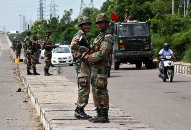 Soldiers stand guard at a highway in Panchkula, India August 28, 2017. REUTERS/Ajay Verma