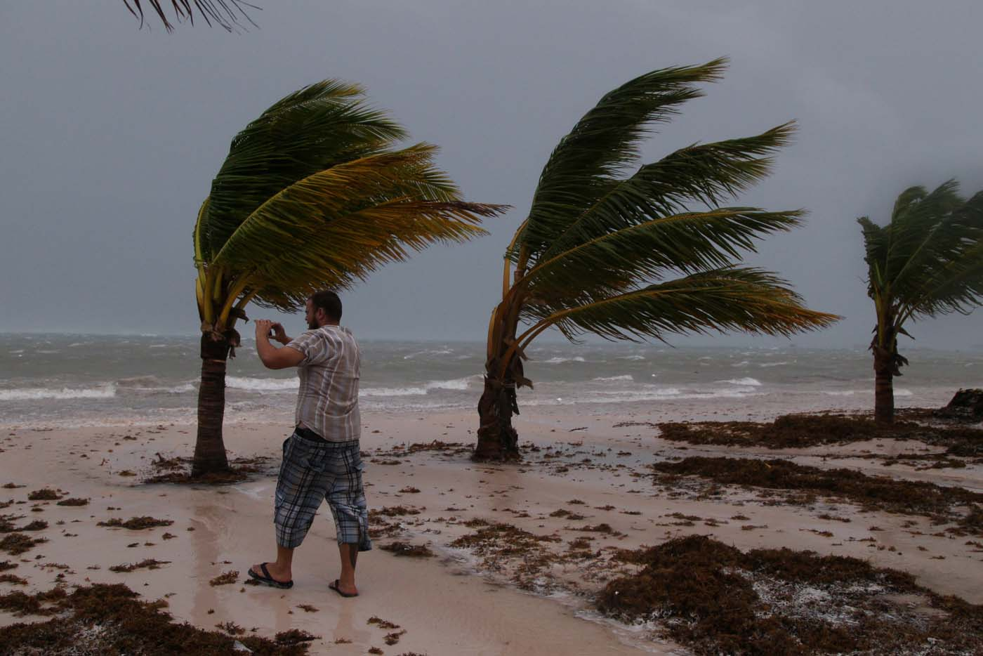 A man photographs the waves before the arrival of Hurricane Maria in Punta Cana, Dominican Republic, September 20, 2017. REUTERS/Ricardo Rojas