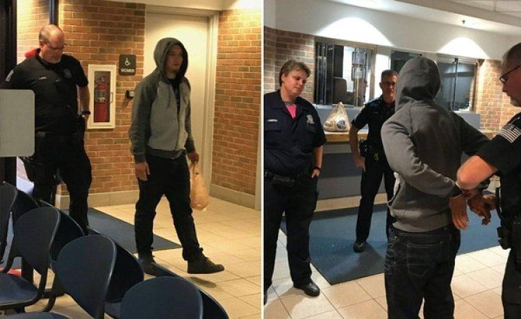 El momento en que el joven ingresa al departamento de policía con su paquete de rosquillas prometido, y lo detienen. (Redford Township Police Department)