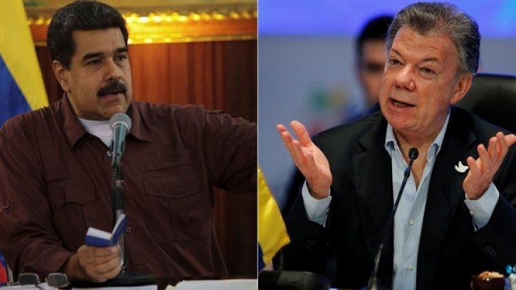 Nicolás Maduro y Juan Manuel Santos (Reuters)