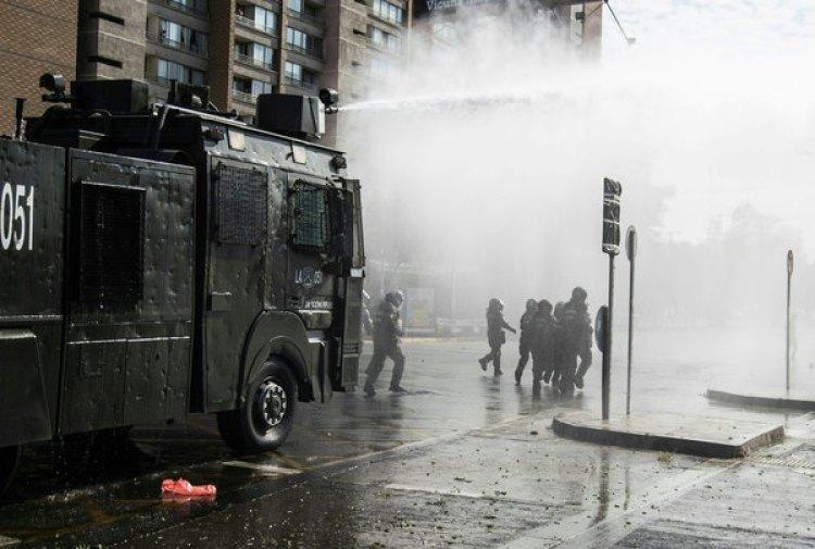 Protestas en Santiago por visita del papa.(AFP PHOTO / Christian Miranda)