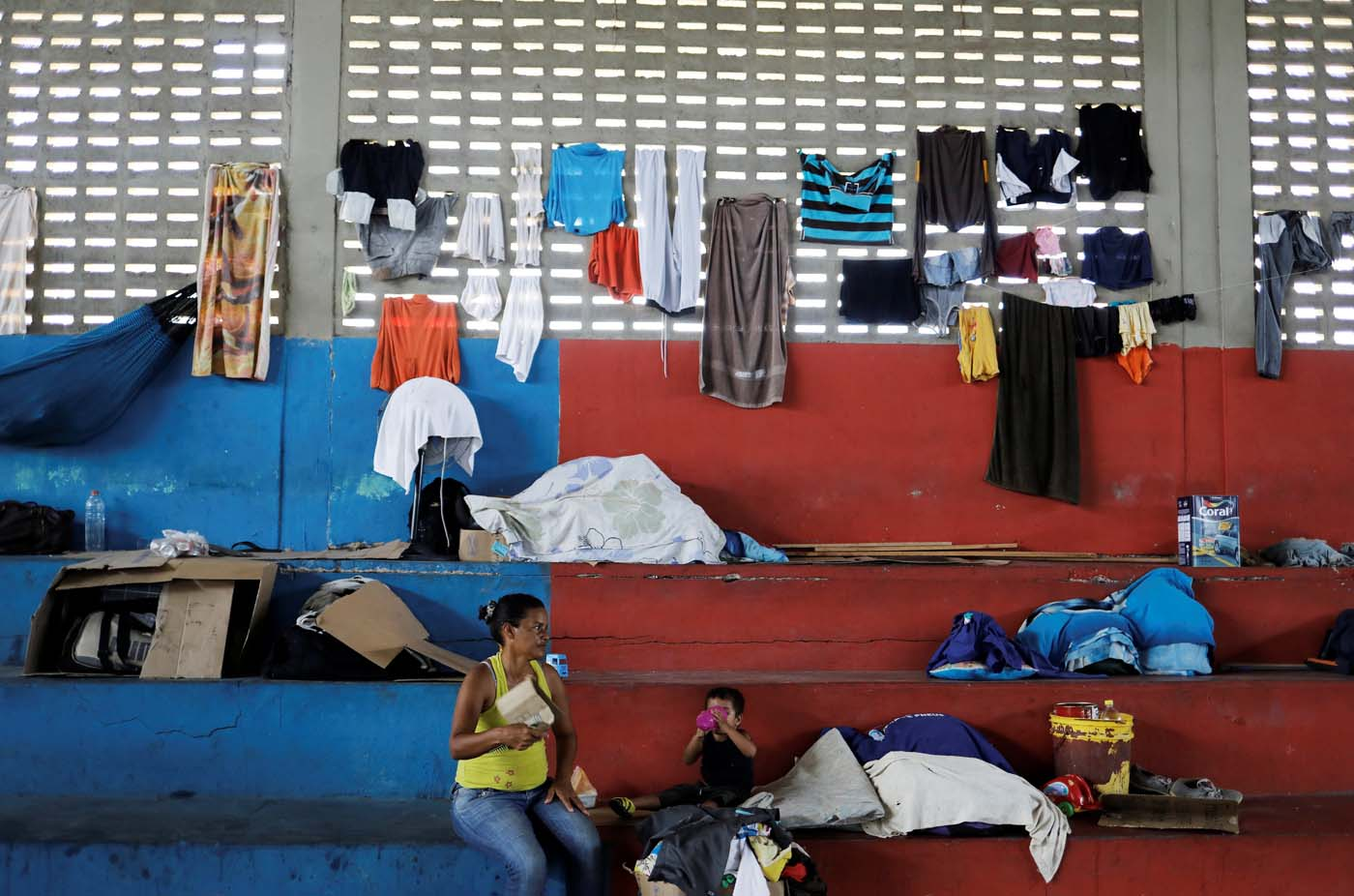 "Venezuelan woman and her child sit at a gym which has turned into a shelter for Venezuelans and is run by Civil Defense with meals provided by Evangelical churches in Caimbe neighbourhood in Boa Vista, Roraima state, Brazil November 17, 2017. REUTERS/Nacho Doce   SEARCH ""VENEZUELAN MIGRANTS"" FOR THIS STORY. SEARCH ""WIDER IMAGE"" FOR ALL STORIES."