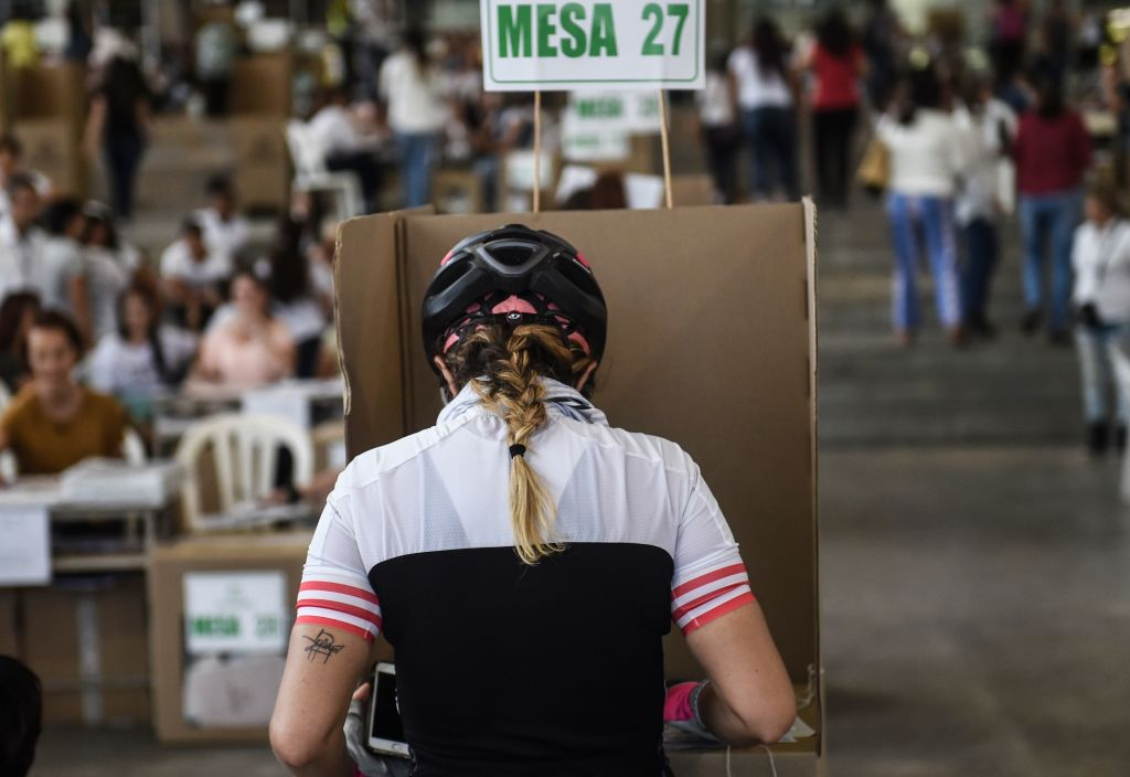 A woman votes at a polling station in Medellin, Antioquia Department, during parliamentary elections in Colombia on March 11, 2018. Colombians went to the polls Sunday to elect a new Congress with a resurgent right, bitterly opposed to a peace deal that allows leftist former rebels to participate, expected to poll strongly. The election is set to be the calmest in half a century of conflict in Colombia, with the former rebel movement FARC spurning jungle warfare for politics, and the ELN -- the country's last active rebel group -- observing a ceasefire. / AFP PHOTO / Joaquin SARMIENTO (Photo credit should read JOAQUIN SARMIENTO/AFP/Getty Images)