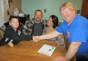 Team owner Jim Howe (right) welcomes Eli Fox (left) to the Jim Howe Motorsports team for 2014 as parents Jamie (second from left) and Morgan Fox look on (Photo: Jim Howe Motorsports)