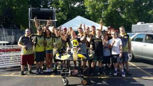 Checkered Motorsports team celebrating the win by Leopard Pro driver AJ Myers