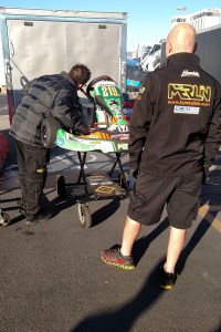 SwedeTech's Jason Barry going over the Stock Moto engine package with the Kalish's (Photo: On Track Promotions - otp.ca)