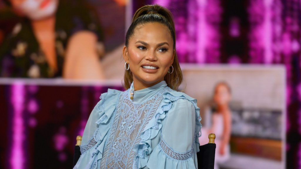 Chrissy Teigen slams critic who said she posts on social media too much: 'Weird and angry'