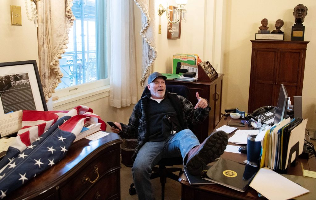 Man photographed with foot on Pelosi's desk during U.S. Capitol riot arrested