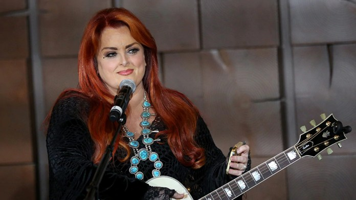 Wynonna Judd says she wept upon seeing sister Ashely Judd for the first time following her leg injury