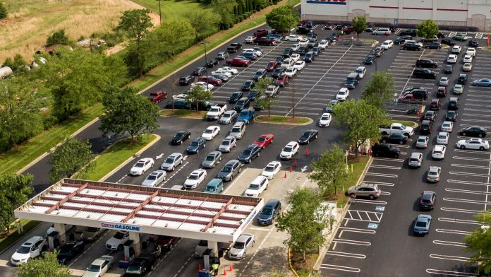 An aerial image of people queuing for fuel at a Costco in North Carolina. Pic AP
