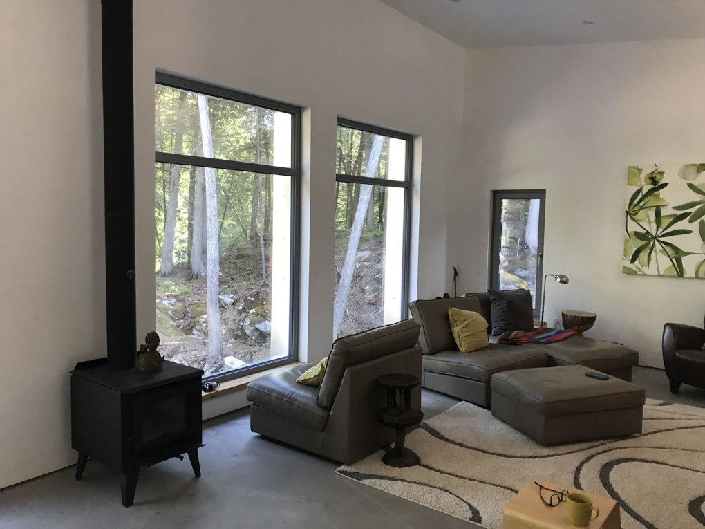 Living room of a passive house with a wood stove