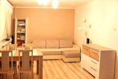 widok na fragment salonu w apartamencie do sprzedaży w Olsztynie