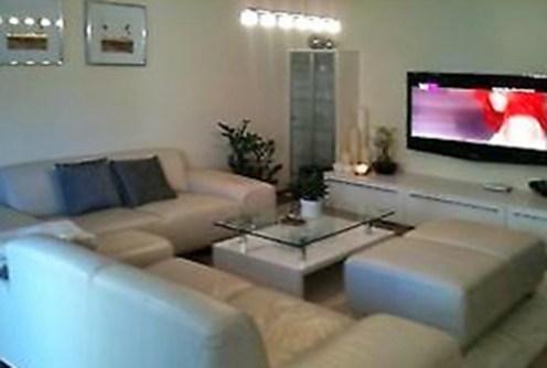 widok na luksusowy salon w apartamencie do sprzedaży w Kaliszu