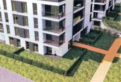 widok z lotu ptaka na zagospodarowaną zieleń wokół apartamentowca w okolicach Poznania, w którym znajduje się ekskluzywny apartament na sprzedaż