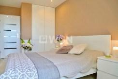 na zdjęciu elegancka sypialnia w luksusowym apartamencie w Szczecinie na sprzedaż