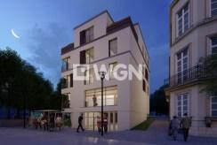 zdjęcie wykonane nocą prezentujące luksusowy apartamentowiec w Kwidzynie, gdzie mieści się ekskluzywny apartament na sprzedaż