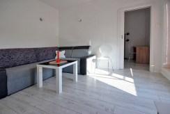 widok na prestiżowy salon w ekskluzywnym apartamencie w Szczecinie na wynajem