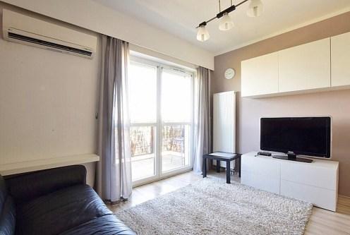 komfortowy salon w ekskluzywnym apartamencie do wynajęcia w Katowicach