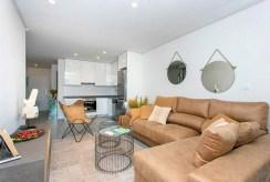 widok z innej perspektywy na luksusowy salon w ekskluzywnym apartamencie do sprzedaży w Hiszpanii (La Zenia)