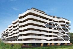 rzut z innej perspektywy na luksusowy apartamentowiec w Krakowie, gdzie mieści się oferowany na sprzedaż ekskluzywny apartament
