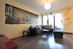 widok z innej strony na luksusowy salon w ekskluzywnym apartamencie do wynajmu Kraków