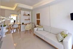 fragment salonu w ekskluzywnym apartamencie do sprzedaży Hiszpania (Costa Blanca, Orihuela Costa)
