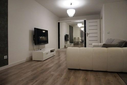komfortowy salon w ekskluyzwnym apartamencie do sprzedaży Wrocław