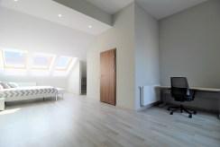 przestronny salon w luksusowym apartamencie do wynajmu Kraków