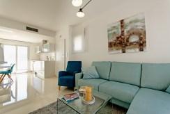 widok z innej perspektywy na ekskluzywny salon w luksusowym apartamencie do sprzedaży Hiszpania sprzedaż