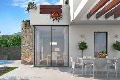 zbliżenie od strony tarasu na salon w luksusowej willi do sprzedaży Hiszpania (Ciudad Quesad)