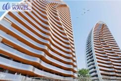 futurystyczny apartamentowiec, w którym znajduje się oferowany na sprzedaż ekskluzywny apartament Hiszpania (Benidorm, Urb. Las Lomas)