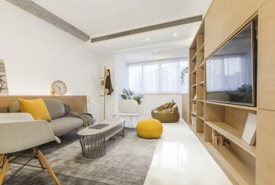 a-large-window-at-the-end-of-the-living-space-lets-in-ample-natural-light