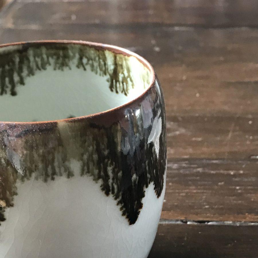 Iron oxide over a celadon glaze - by Elaine Bolt