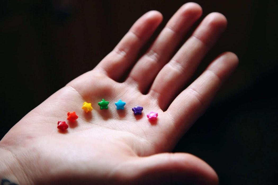 Rainbow coloured stars in palm
