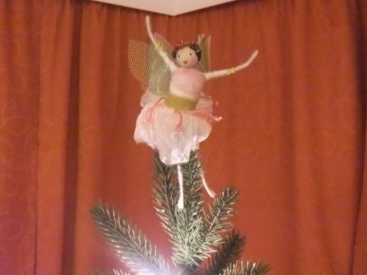 The fairy on top of the tree.