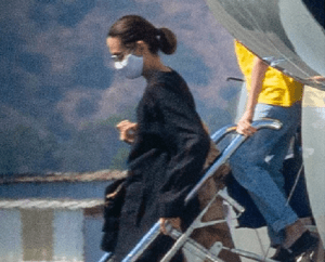 Angelina Jolie dons a facemask as she arrives with her kids on a private jet in Burbank after a short trip
