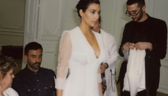 Kim Kardashian shares throwbacks of herself trying on her wedding dress after denying reports she is 'torn' about leaving Kanye West 3