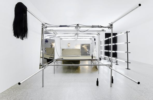 PEPO SALAZAR Untitled Installation (La fiesta de los metales), 2009 Fluorescent tube, stainless steel, 2G, paint, DM, stainless steel sheets, tripods/lamps, wig, botles.