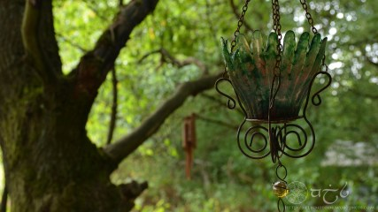 A small, well placed hanging lantern