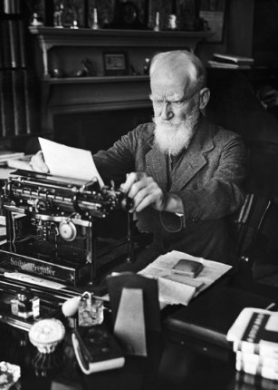 Irish playwright George Bernard Shaw dealing with his correspondence at the typewriter, when his secretary Miss Blanche Patch is busy, in his London flat, on June 13, 1932. (AP Photo/Alfred Eisenstaedt)