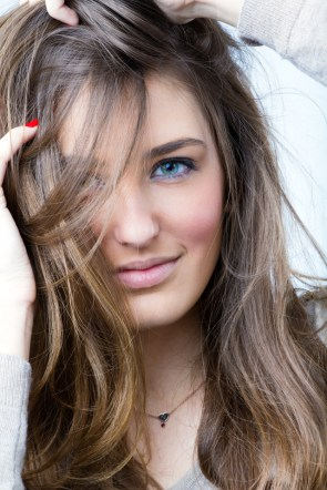 studio portrait of beautiful young woman posing