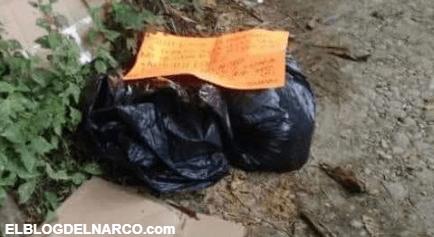 Hallan restos humanos embolsados en una brecha sobre la carretera junto a narcomensaje en Jalisco, Guadalajara