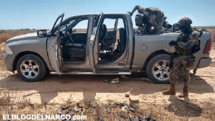Marinos hallan camionetas y armas que sicarios abandonaron en Caborca, Sonora
